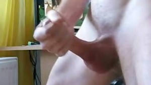 cumshot with background fucking couple