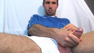 Ludo, a sexy soccer player get wanked his huge cock by a guy !