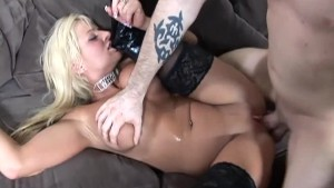 Busty blonde fucked in black boots over stockings