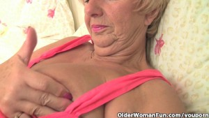 Chubby granny gets her old pussy fingered by photographer