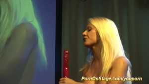hot nfcm show on public stage with sexy blonde babe