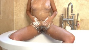 Jasmine Z washes her hairy pussy and hairy body