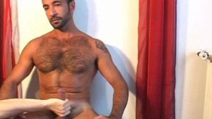 A real straight mature arab sport guy gets wanked his hard cock by a guy in spite of him !