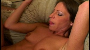 Pretty brunette parts her hairy pussy