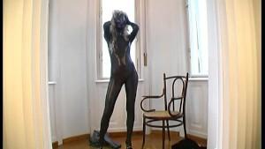 Magdi in black fullbody catsuit