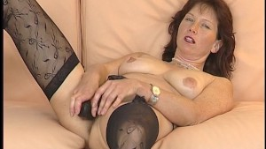 Milf plays with her toys