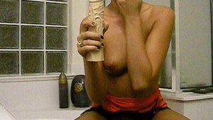 hot chick fucks herself with a giant dildo