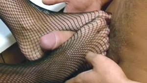 Housewife in fishnets with sexy feet