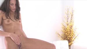 Beautiful skinny brunette Celeste Star fucks herself with dildo