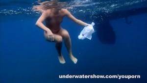 Nude swimming in the sea