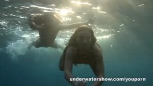 Julia and Masha are swimming nude in the sea