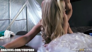Nikki Benz is frisked and fingered before being bent and banged