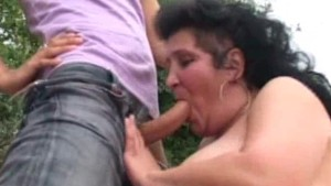 Granny double-teamed outdoors