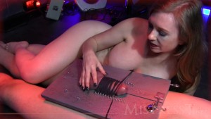 Bound cock brought to orgasm by slight touch.
