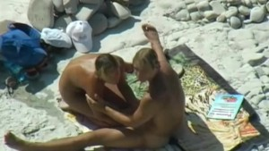 Hot couple gets caught on camera having sex on the beach