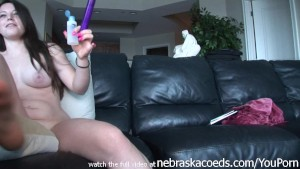 girl next door banging herself with a dildo on my black couch