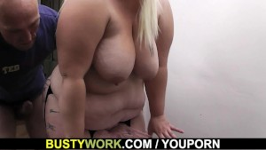 Blonde secretary in stockings pounded on the table