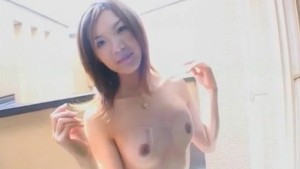 Noa Tsukishima pees in glass and arouses her pussy on balcony