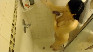 Busty unaware girl spied by a shower camera