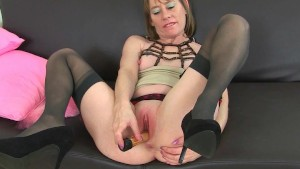British milf Sexy P wears stockings with suspenders