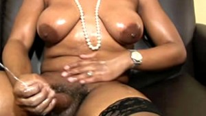 Full figured black TS exposes black boobs and huge shecock