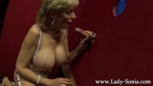 Blonde milf Lady Sonia sucking big dick on the glory hole