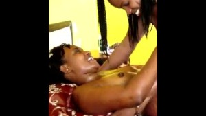 Gorgeous African with hot curves puts some oil on her girlfriends body